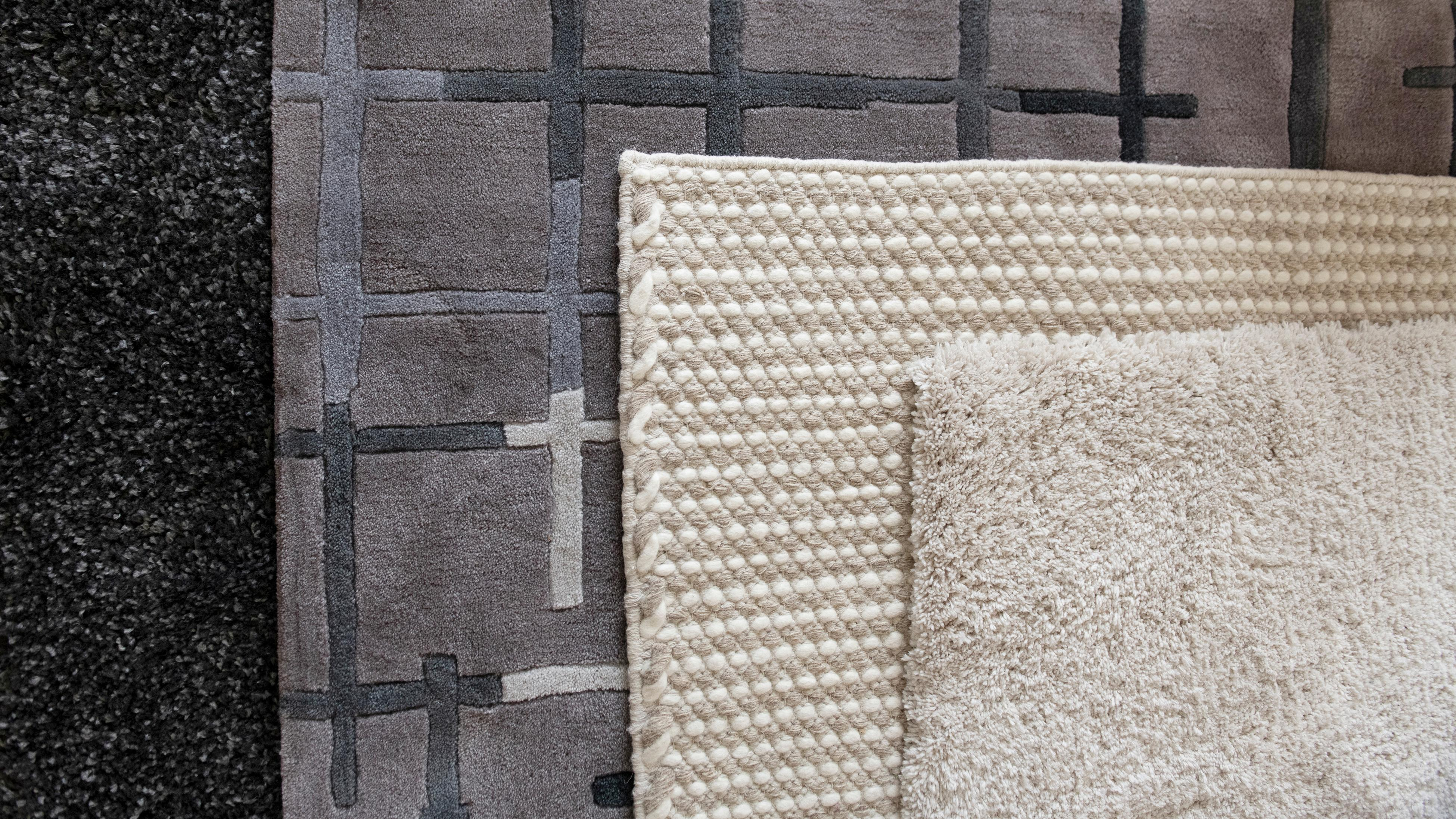 Three different types of rug.