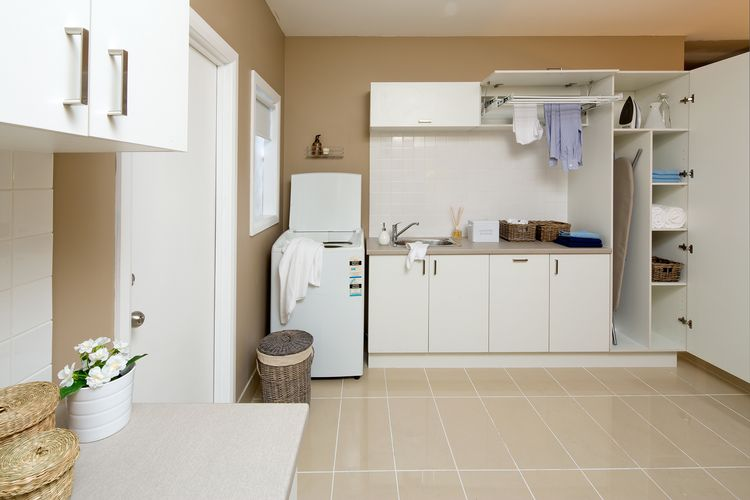 Laundry with cabinets and washing machine