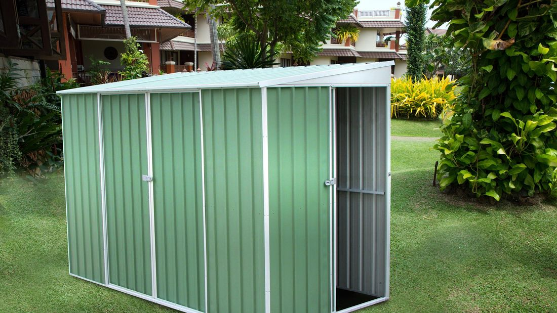 A small metal-framed garden shed