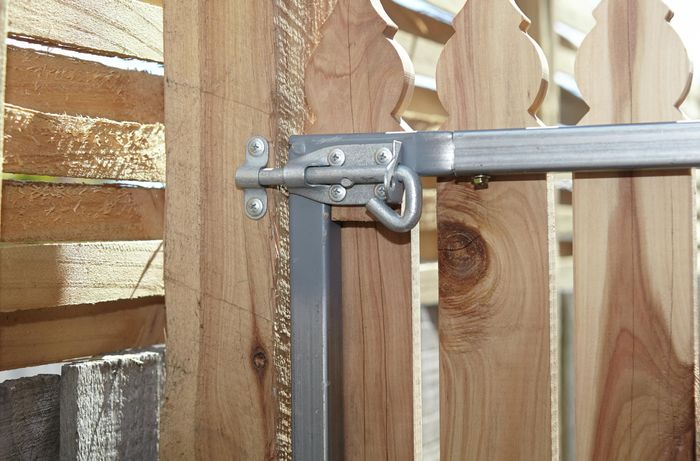 The back of a picket gate showing the pad bolt secured