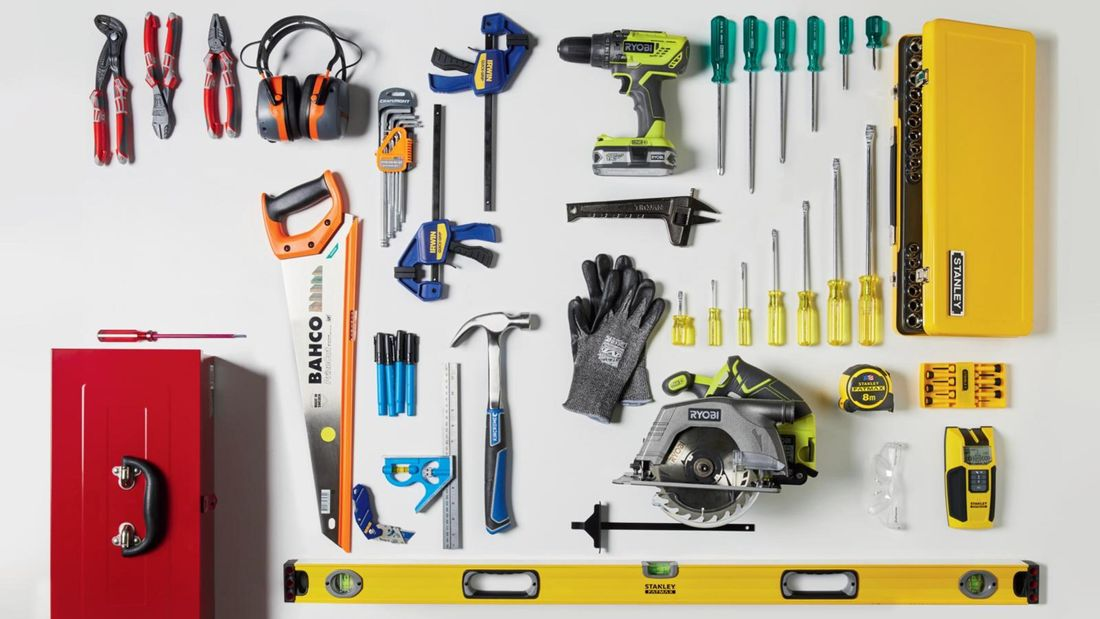 Tools laid out on benchtop, including a Bahco saw, earmuffs and Stanley screwdrivers.