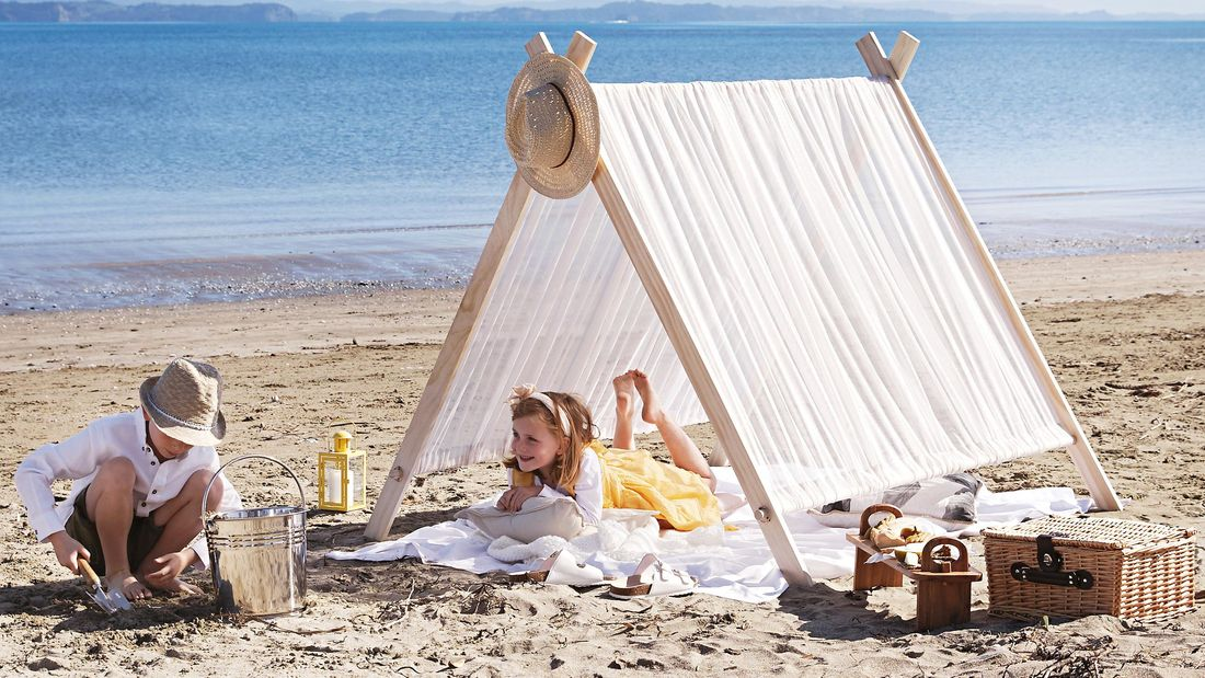 Two kids enjoying a finished beach tent in situ