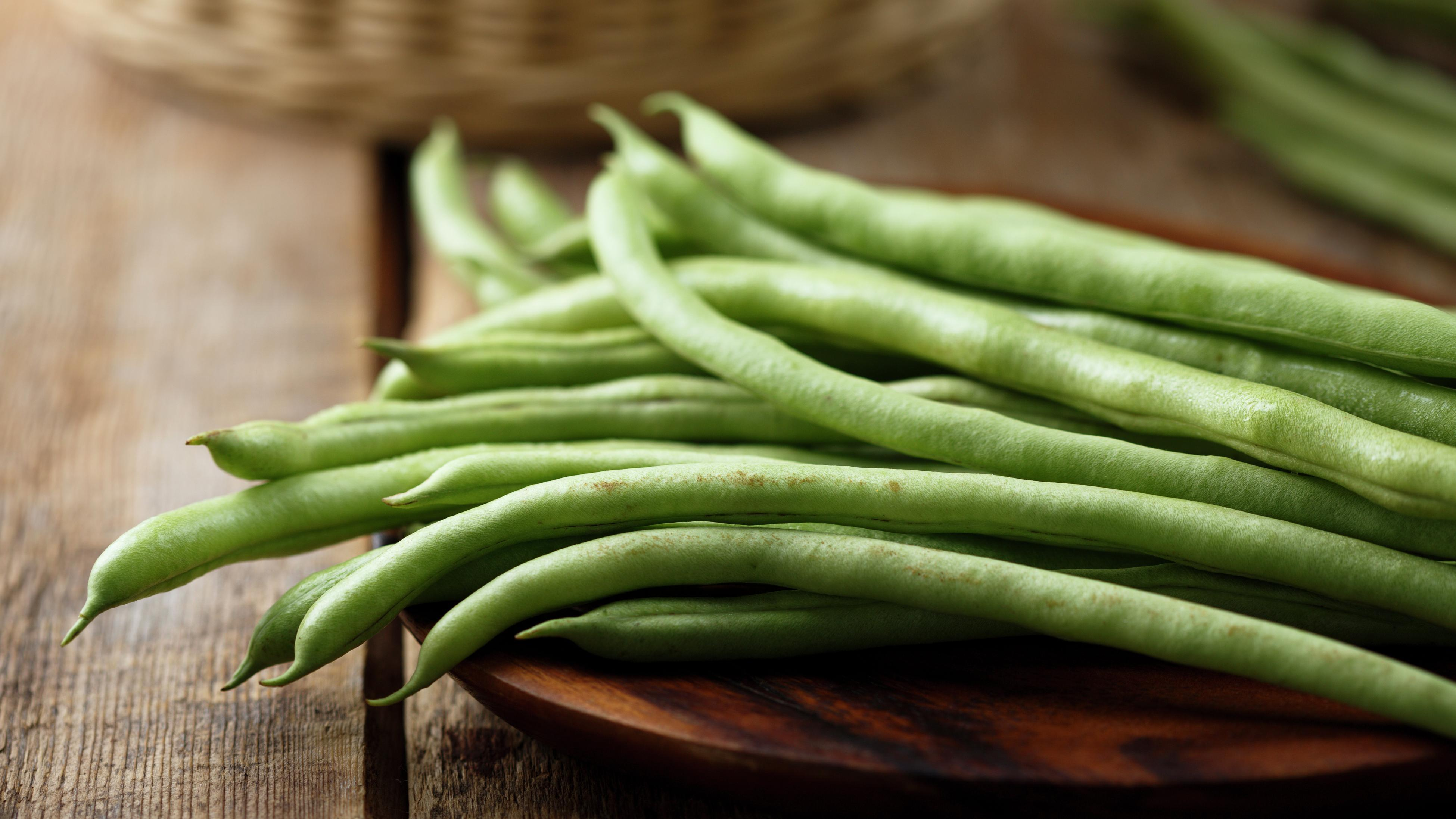 close up of green beans on a cooking board