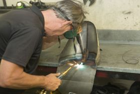Person welding while wearing mask