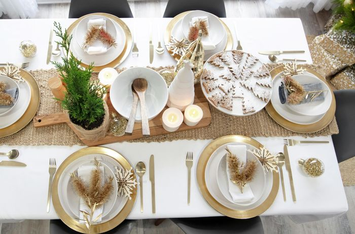 Overhead view of a dining table set and decorated for Christmas