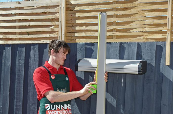 Measuring the length from the top of the post down to the middle of the unit.