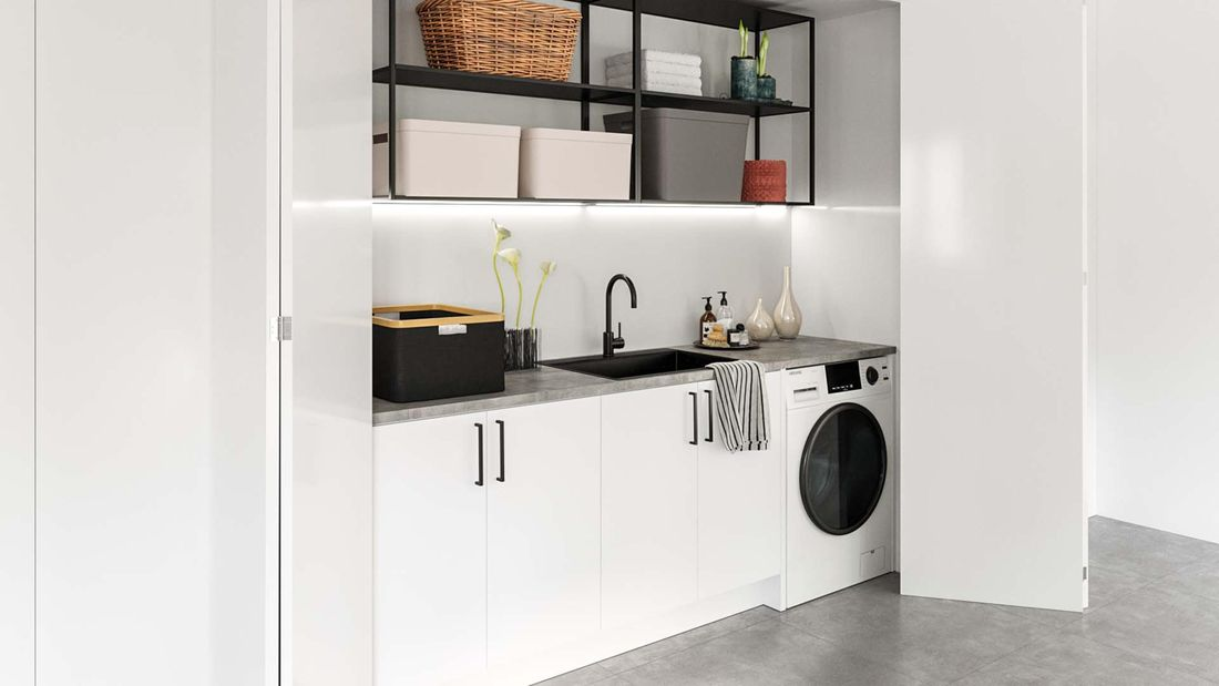 European cupboard laundry with white bi-fold doors, contemporary stone benchtop and modern shelving