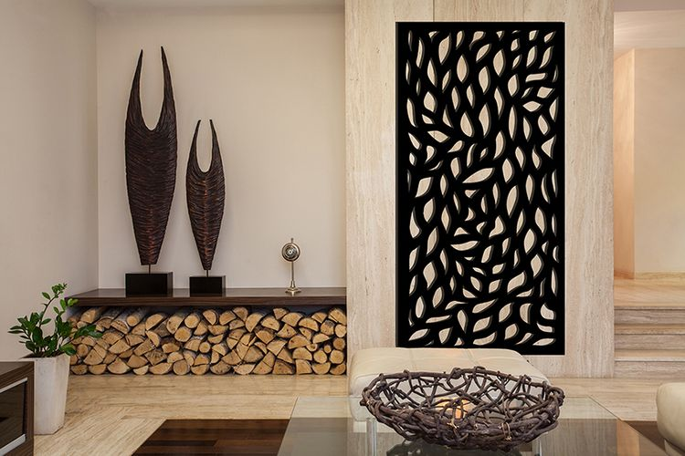 Lounge room with couch, stack of firewood, sculptures and decorative screen on wall