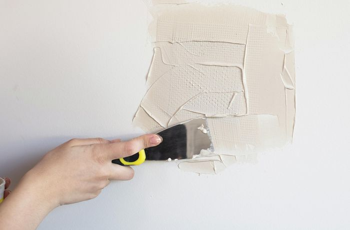 Applying another layer of Smooth Coat plaster