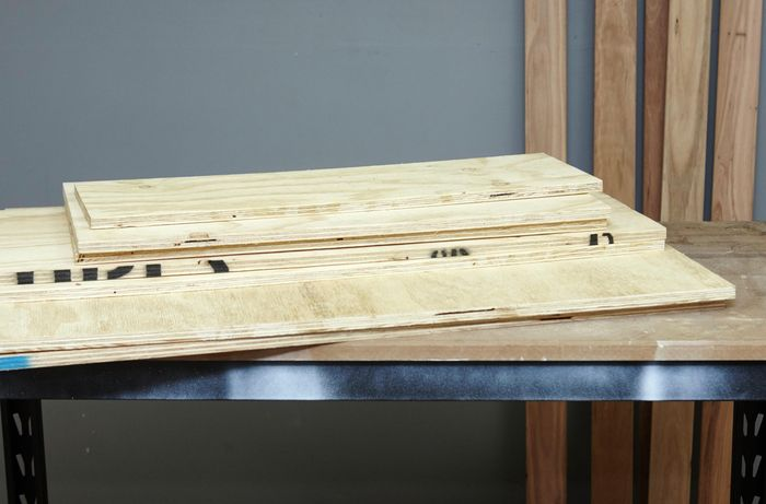 Panels of ply timber on a workbench