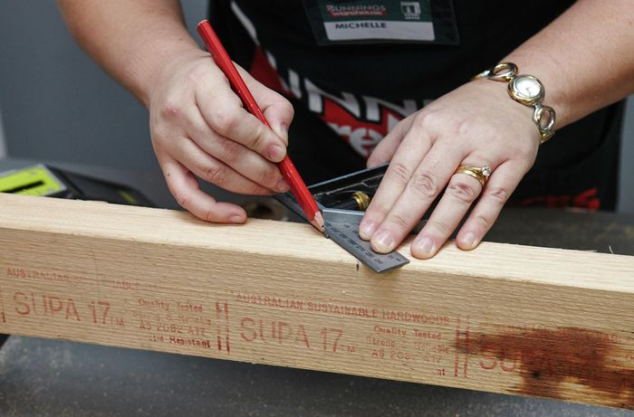 A 45 degree mark being ruled onto a length of timber for a corner piece