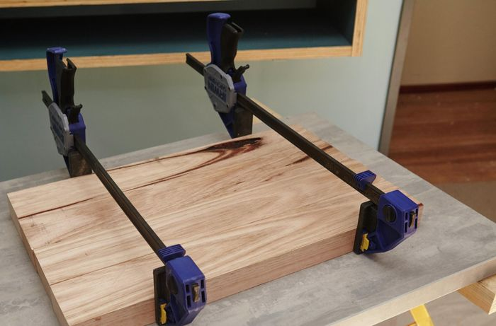 Four lengths of timber held together with clamps