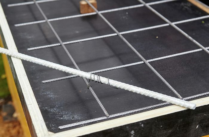 Reinforcing mesh sitting on top of form ply frame.