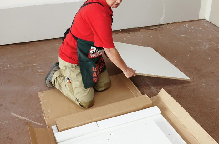 Person unpacking cabinet flat pack