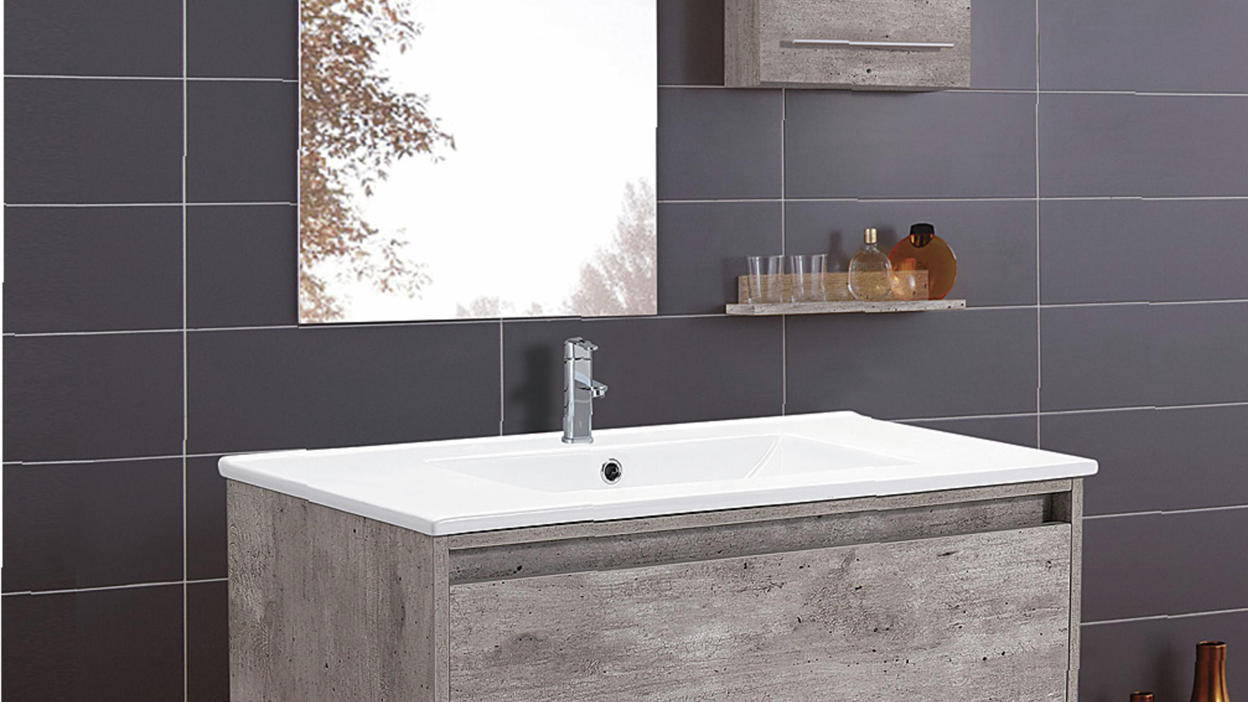 Bathroom featuring undermount sink/basin, grey tiling and mirror.