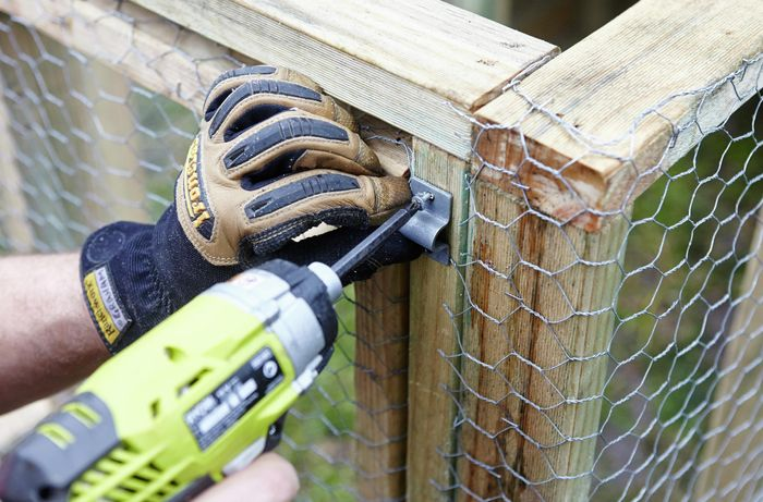 The latch for a simple slide lock being fitted to the outside of the chicken coop