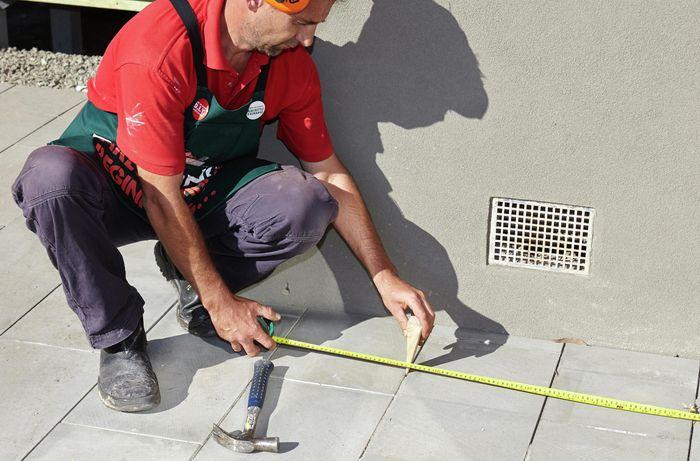 Person measuring pavements.