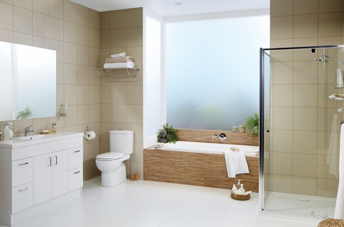 Bathroom with a white and beige colour scheme. There is a bath, shower and sink in shot.