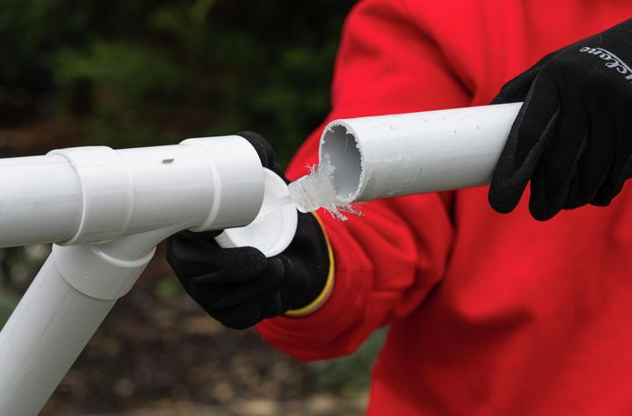 using plumbing cement to join pvc pipes together