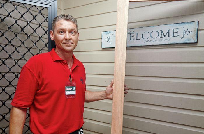 Bunnings team member Glen holding a length of hardwood