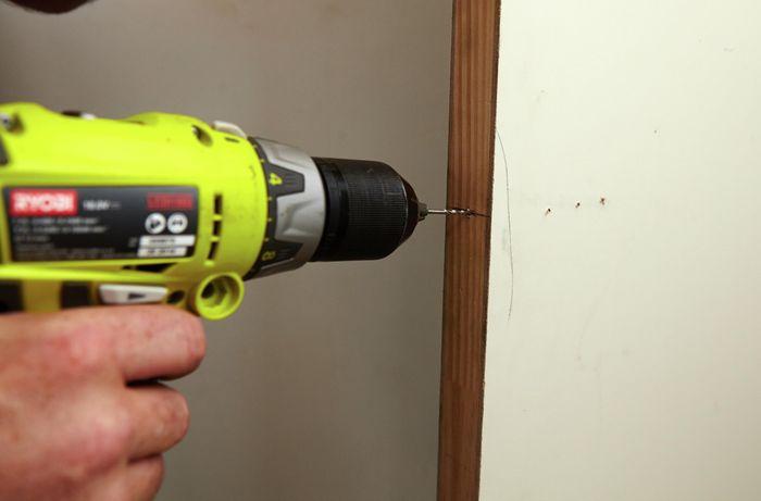 Drilling into a door to make way for a door handle