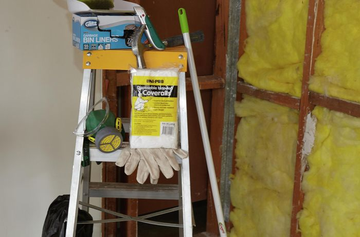 Tools and materials required for this project, including disposable coveralls