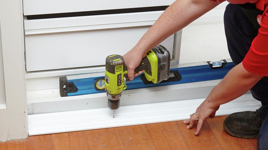 DIY Step Image - How to install a sliding wardrobe door . Blob storage upload.