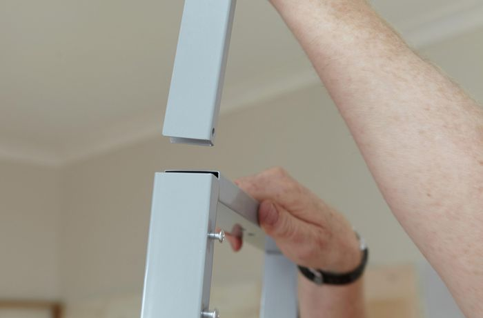 A U-iron being fitted to the pull out pantry basket's frame