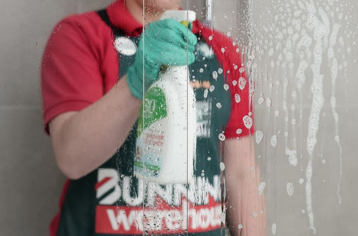 spraying of shower cleaner