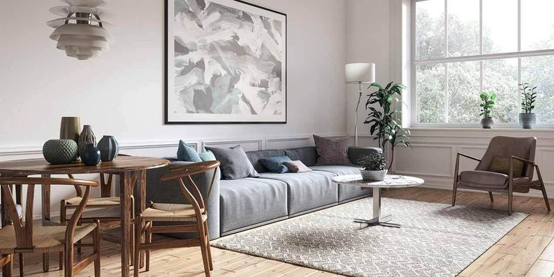 Furnished lounge room with a pale colour tone