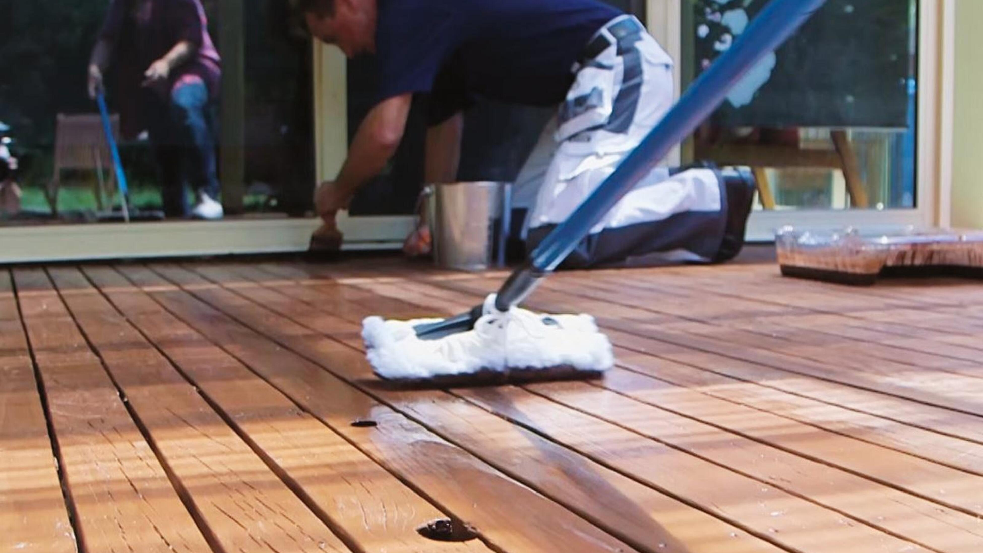 Second coat of decking oil being applied with lambswool applicator.