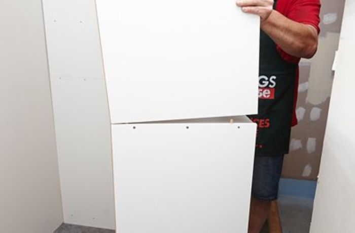 Placing the top unit onto the bottom unit.