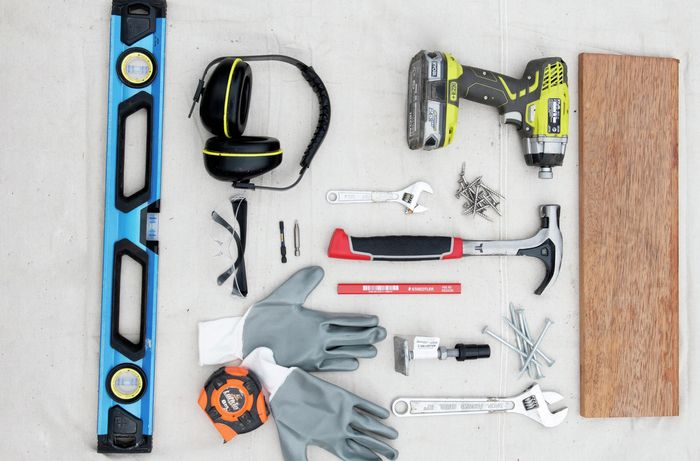 Tools and materials needed to install modular decking.
