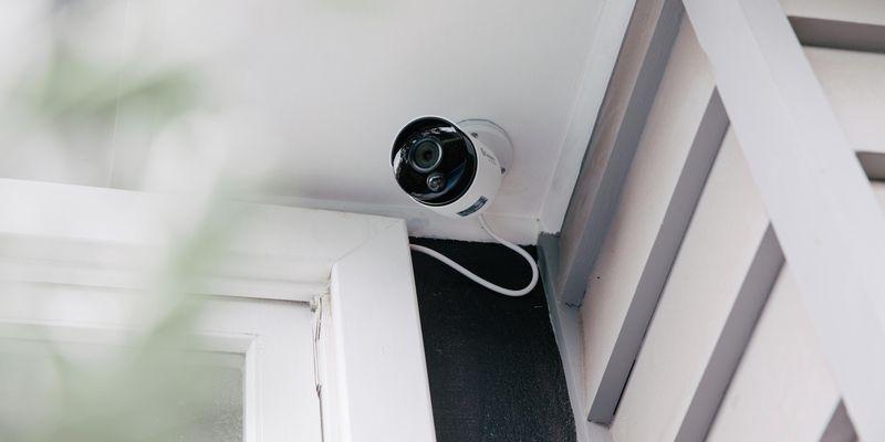 Front door with ring security doorbell. The house is weatherboard.