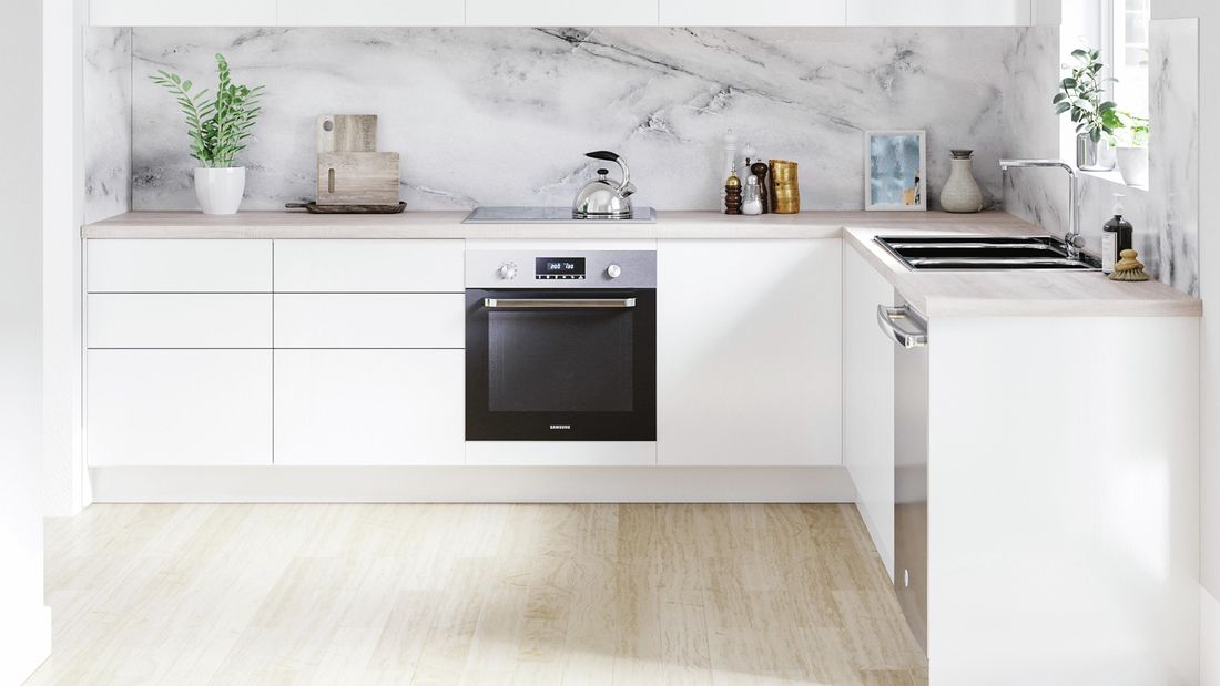 Kitchen with white and timber cabinets, timber benchtop and marble splashback.
