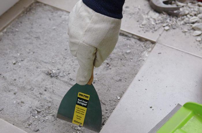 DIY Step Image - How to replace a broken floor tile . Blob storage upload.
