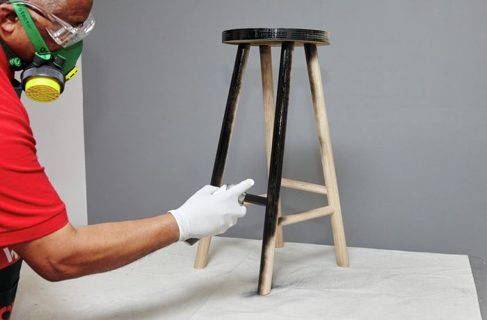 A finished bar stool being spray painted black