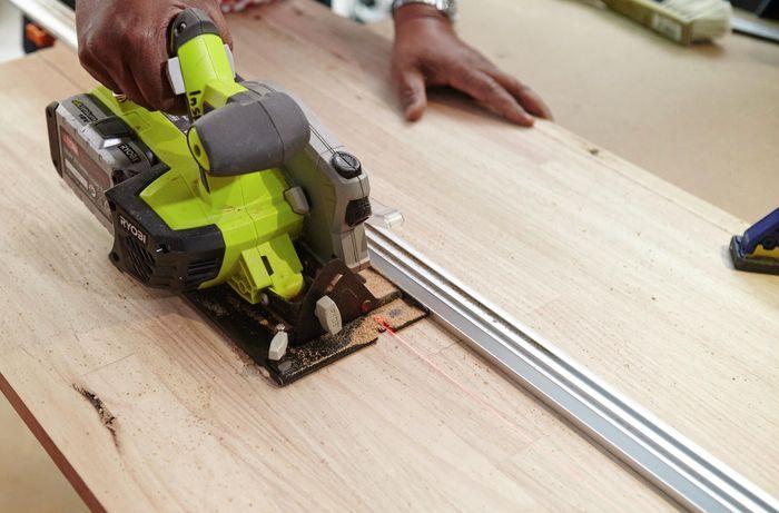 Person using circular saw to cut hardwood