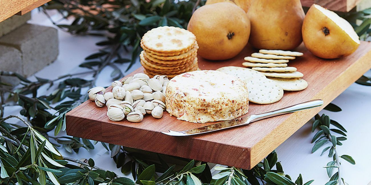 Grazing board with cheese crackers pistachios and pears