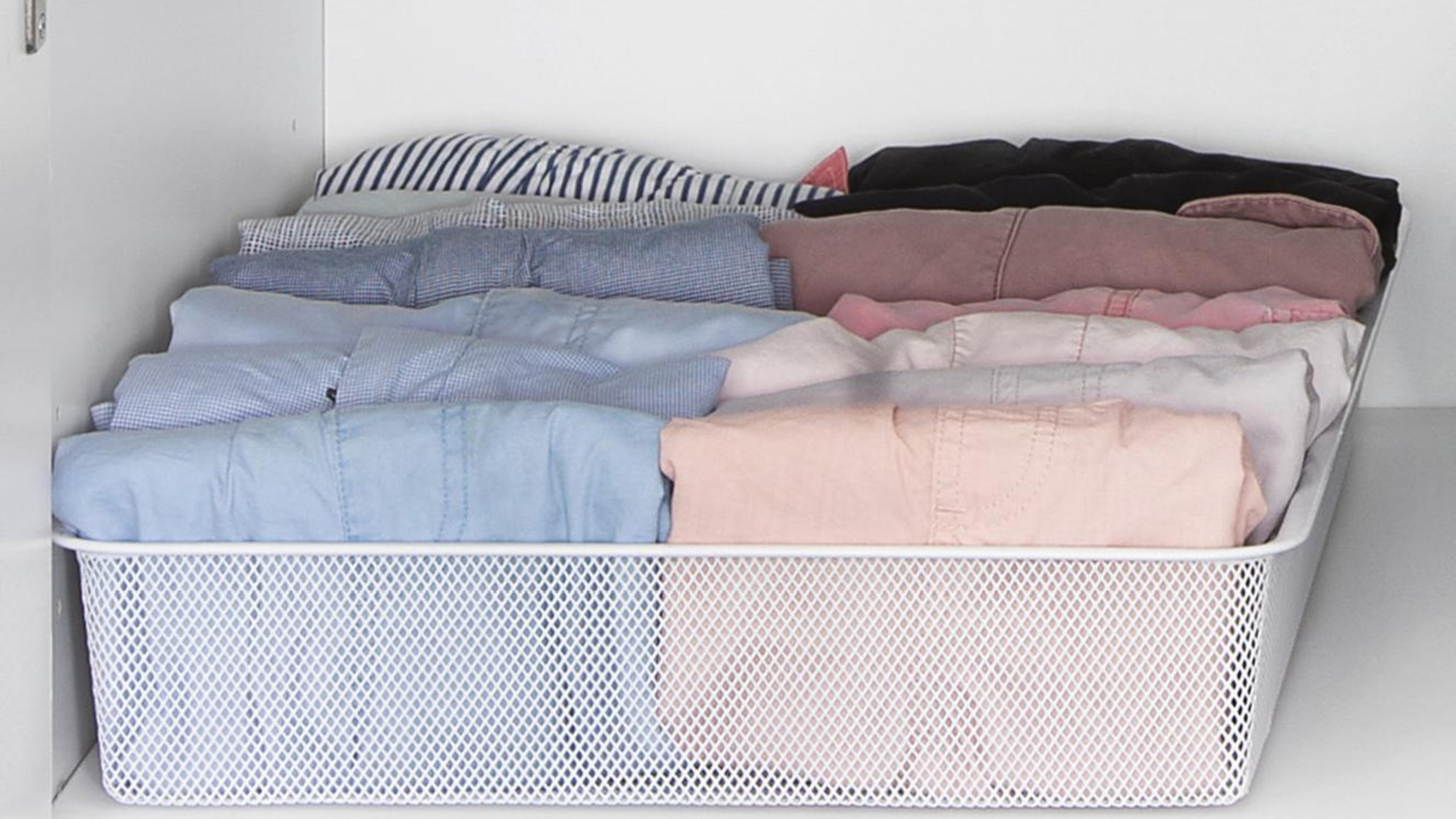 Clothes folded into a basket tray.