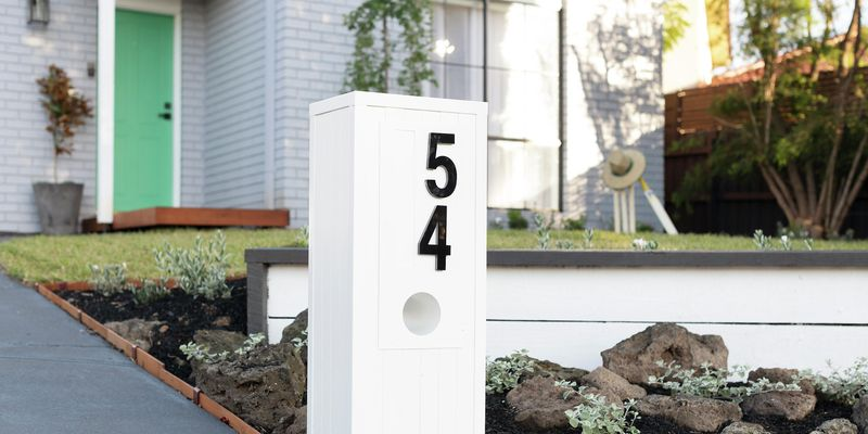 Letterbox at the front of a house with the number 54