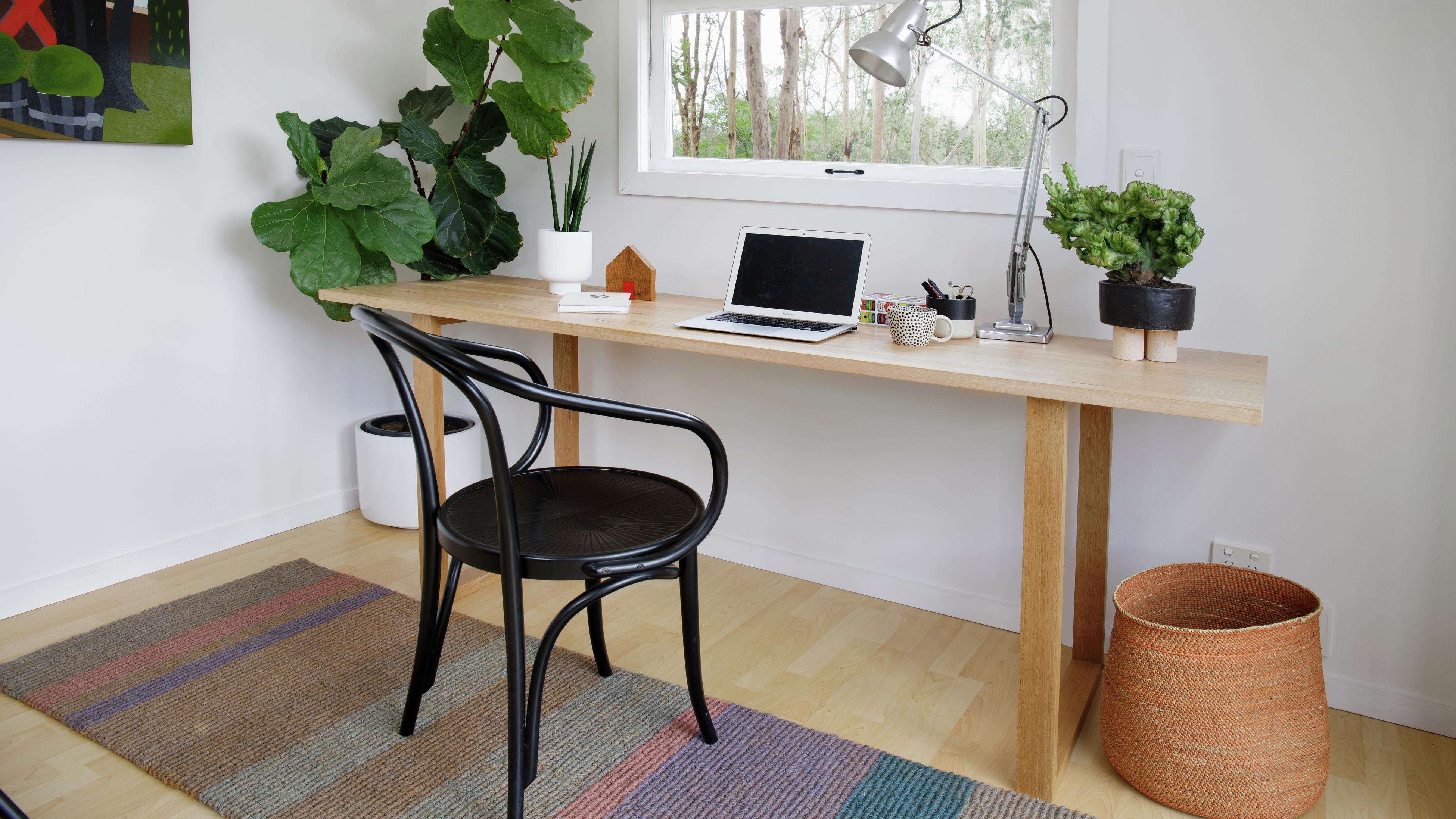 Chair, desk and window in a home office looking onto garden
