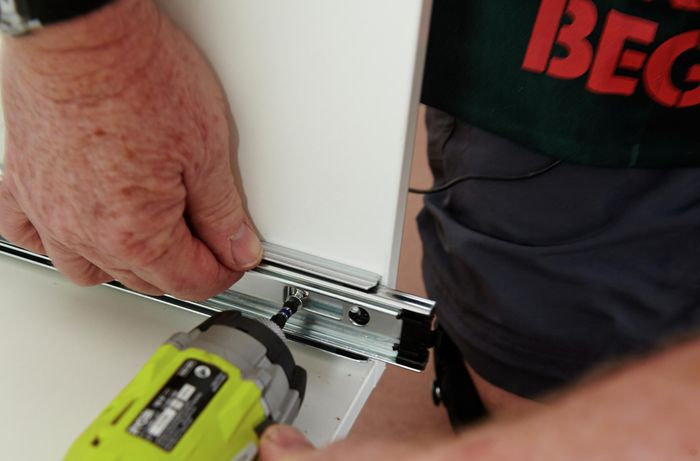 DIY Step Image - How to install drawer runners . Blob storage upload.