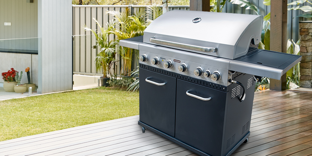 Moderate-sized barbecue on a timber deck