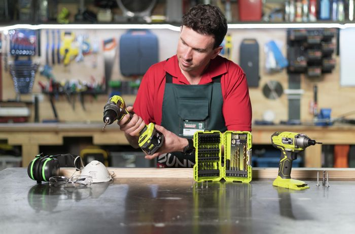 Team member with an assortment of different tools