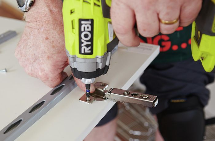Hinges being fixed to a pantry door