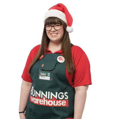Female Bunnings team member wearing Santa hat