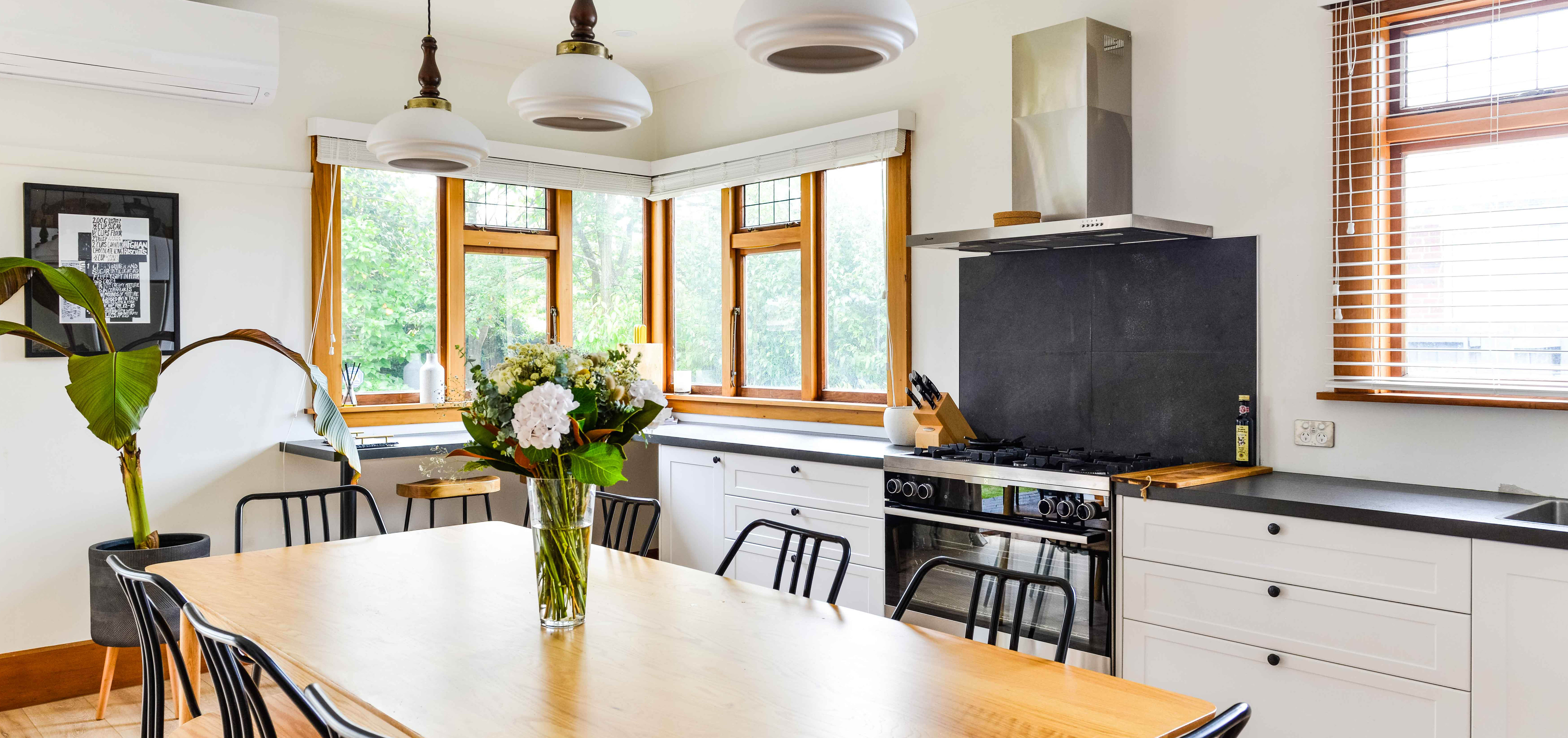 kitchen and dining table with a vase on it