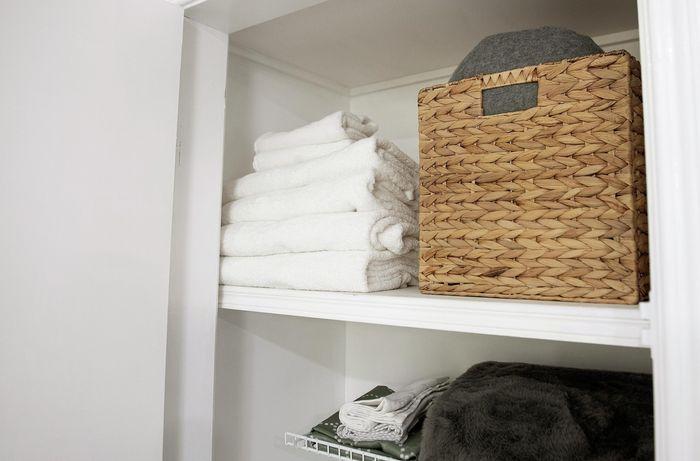 Towels and basket on a shelf