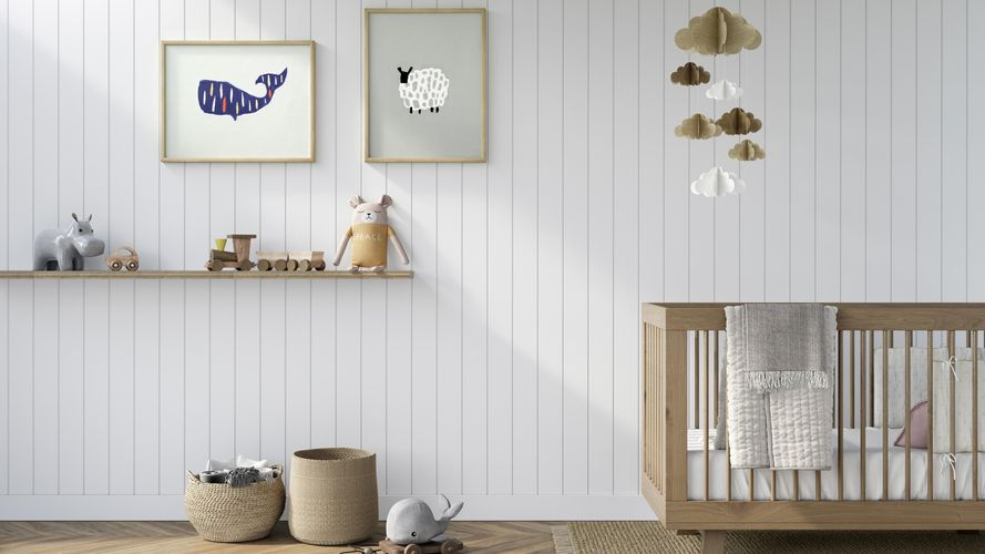 Baby room with timber crib, shelf with toys, prints on walls and timber flooring in neutral tones. Classic VJ 100 design in Dulux Warm White.